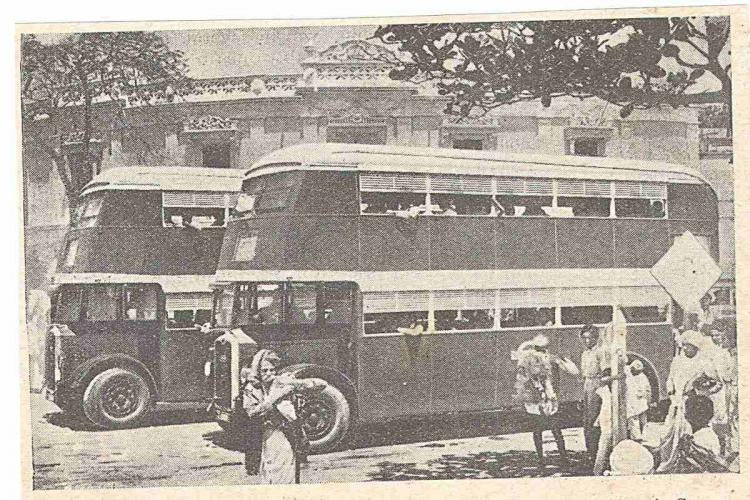An old black-and-white photo showing two double-decker buses in Hyderabad