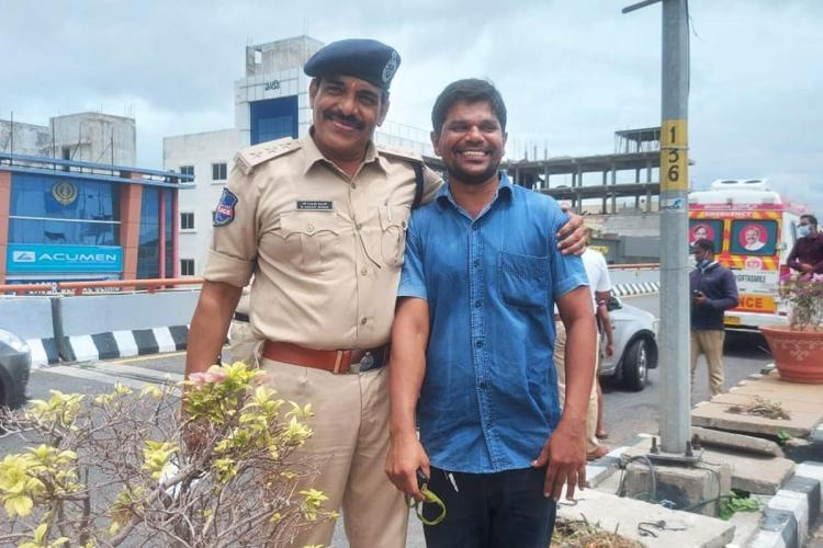 ACP Sanjay Kumar shares a moment with Ravi who rescued the mother and children