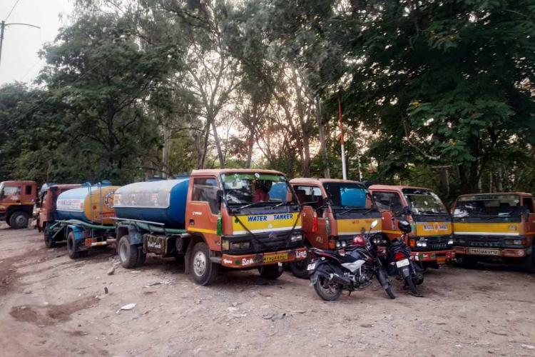 Water tankers parked outside the filling station