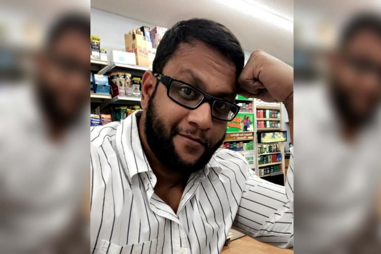 The victim Mohammed Arif Mohiuddin who was murdered in Georgia USA in a white striped shirt looking at the camera