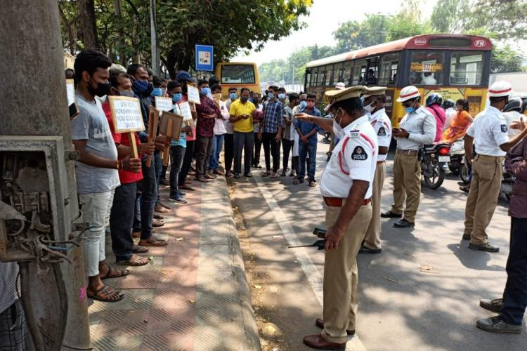 Hyderabad traffic police conducting a mask awareness to a gathering on road