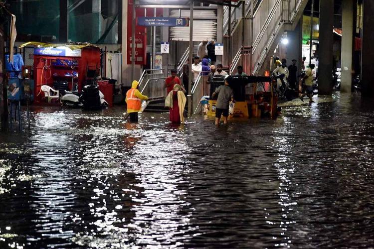 Waterlogging near metro station stairs in Hyderabad