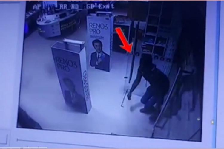 A screengrab from the CCTV footage shows a burglar entering the Reliance Digital store in Hyderabad