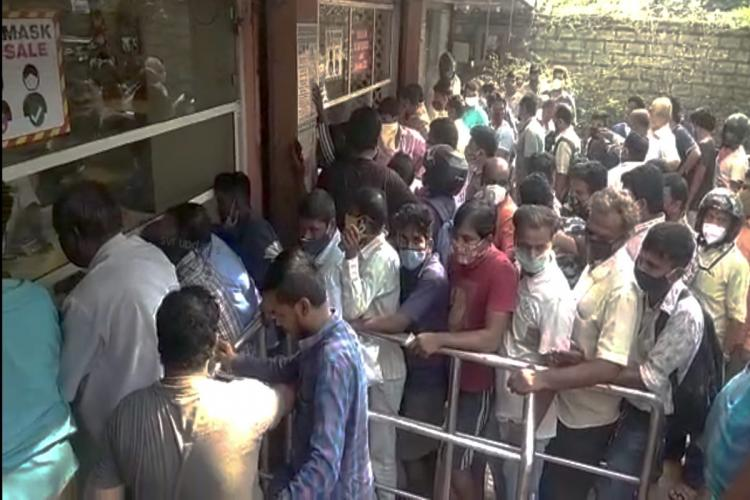 An image showing a crowded liquor store premises in Hyderabad