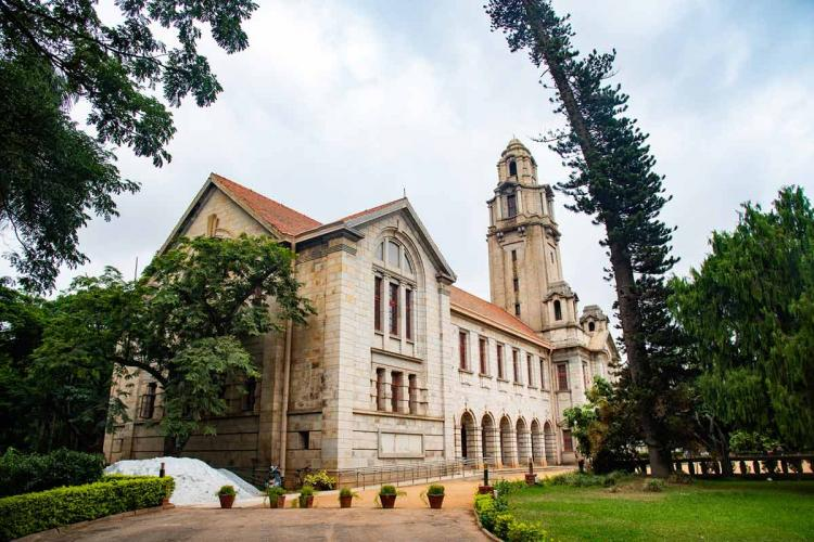 File photo of IISc in Bengaluru against trees and a cloudy sky