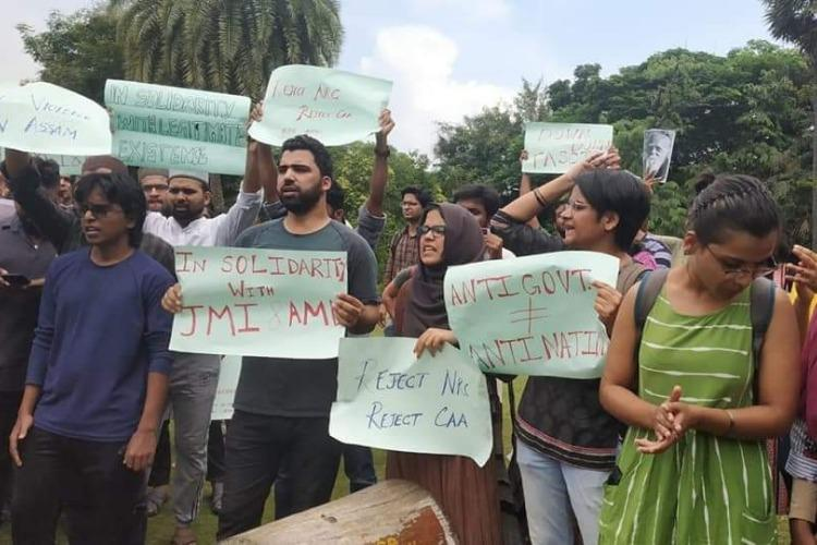 Stop state terror IIT Madras students rip and burn copy of Citizenship Act