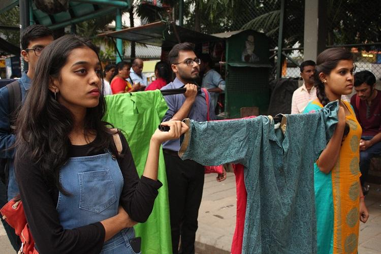 Bengaluru women march holding clothes they wore while they were sexually harassed