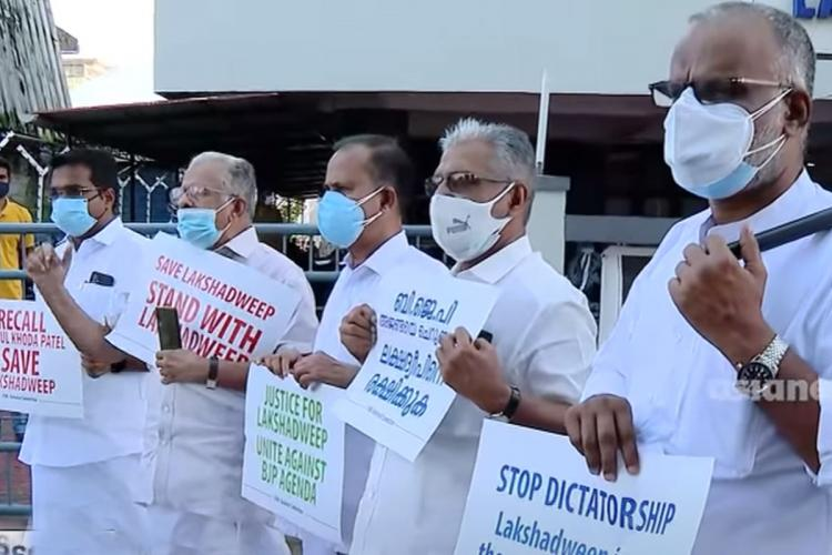 Indian Union Muslim League leaders wearing mask and holding placard stage protest against Lakshwadeep reforms