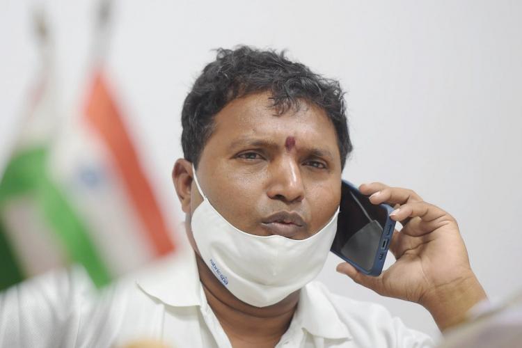 Crinivas BV talking on phone