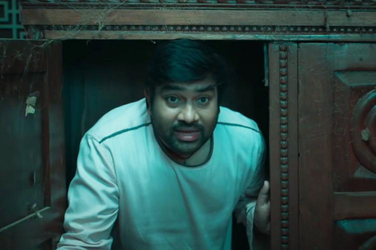 Shiva is seen peeking outside a door in the image