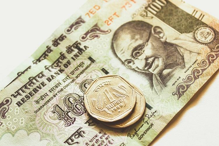 Rupee slips 5 paise to 7117 against US dollar in early trade