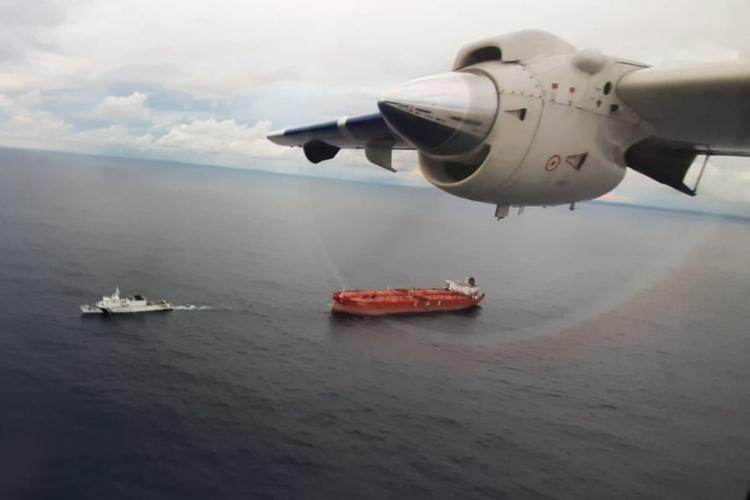 Coast guard aircraft hovering over the oild tanker moving towards Nicobar islands