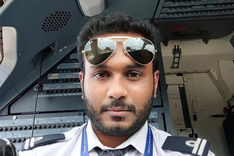 Captain Priyavignesh wearing shades inside cabin