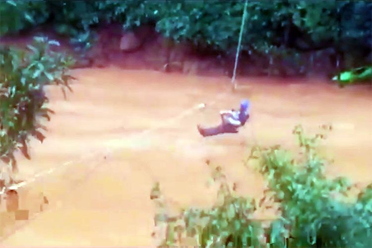 Watch Rock climber ziplines 2-month-old baby across fast flowing water in Kodagu