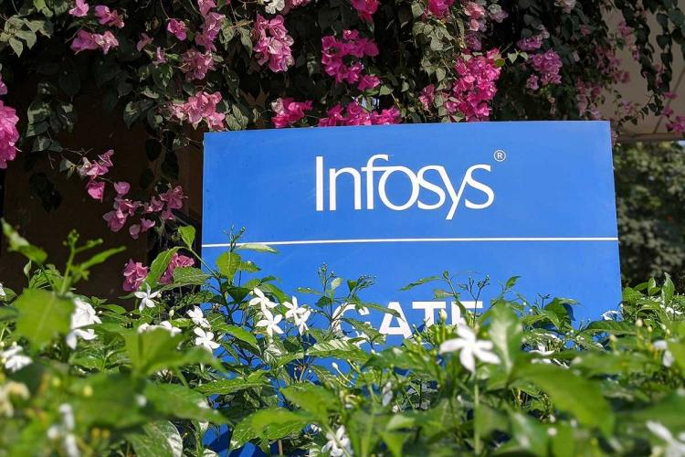 Infosys logo amid plants at its office