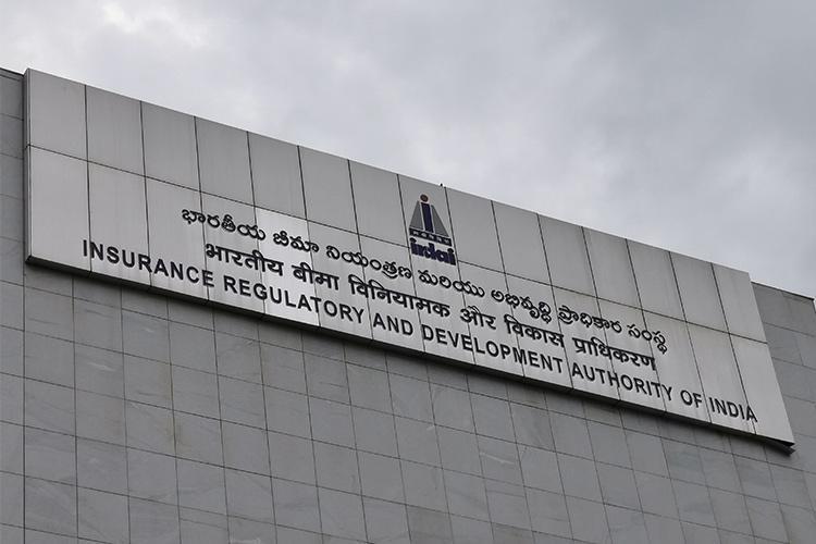 Grey sign board of the IRDAI against a grey sky