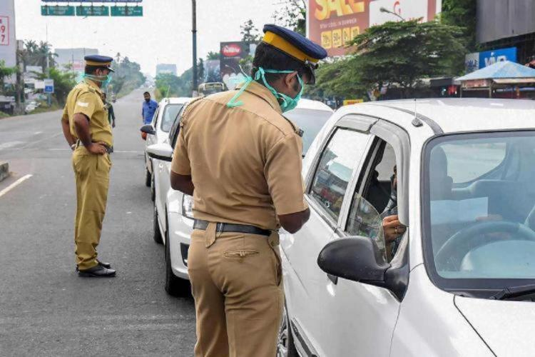 Police personnel checking the epass