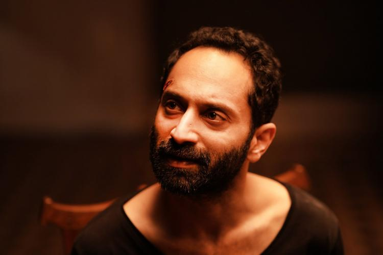 Fahadh in a black T shirt looking to the side in Irul