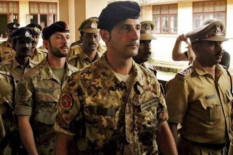 Two Italian marines who shot dead two Indian fishermen off Kerala coast arriving at a court accompanied by police at a court