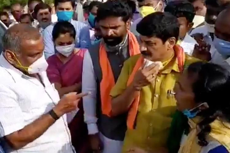 JC Madhuswamy in a scuffle with a farmer leader