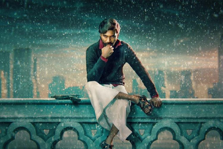 Dhanush in black shirt and white dhoti sitting on a wall in Jagame Thandhiram poster
