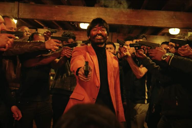 Dhanush is seen as a gangster and is surrounded by other men in the poster