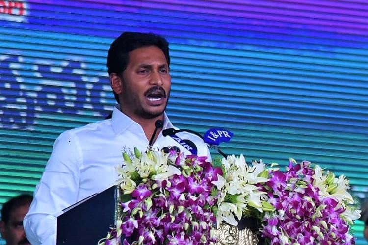 Andhra Chief Minister Jagan signs first file on stage, increases old
