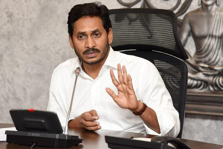 Andhra Pradesh Chief Minister Jagan Mohan Reddy sitting in his office