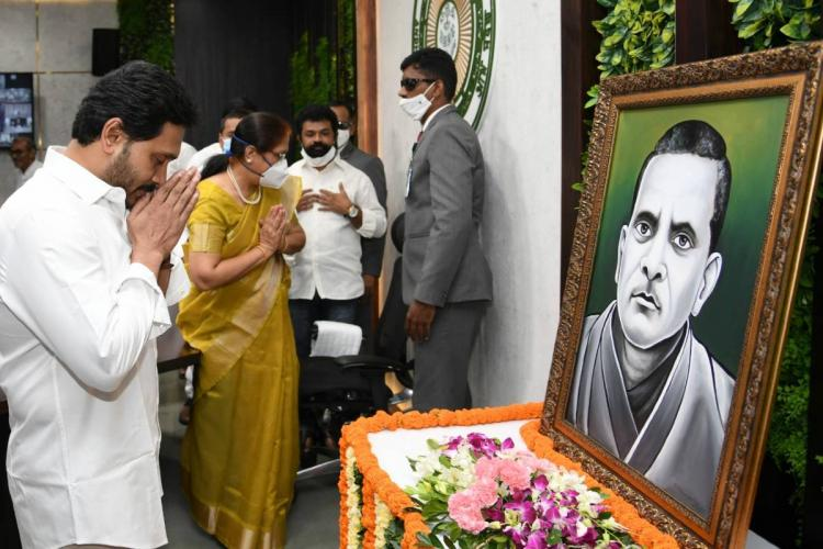 Andhra Pradesh Chief Minister Jagan folding hands in front of a portrait of Potti Sriramulu