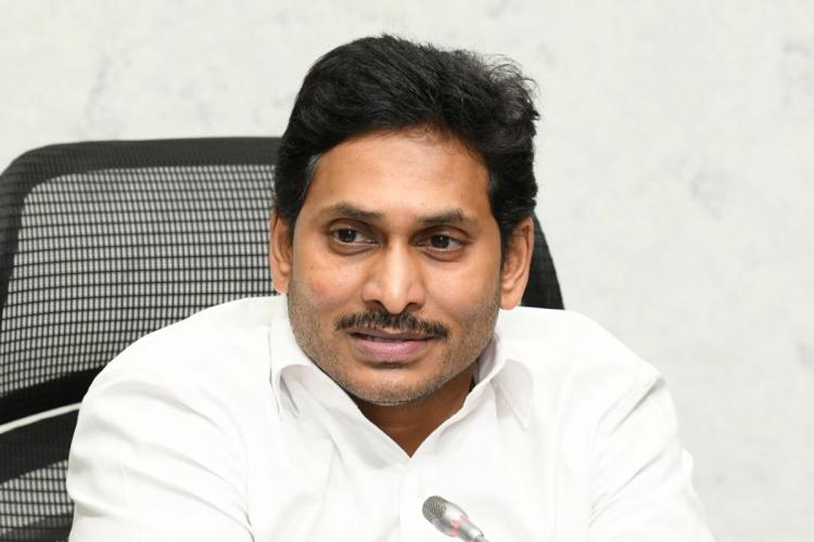 Andhra Pradesh Chief Minister Jagan Mohan Reddy wearing a white shirt sitting in his chair