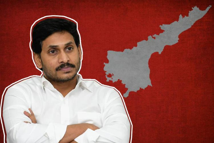 Andhra CM Jagan posing in a white shirt with Andhra map beside