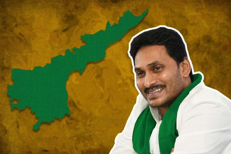 Andhra Chief Ministre Jagan Mohan Reddy seen smiling beside Andhra Pradesh state Map