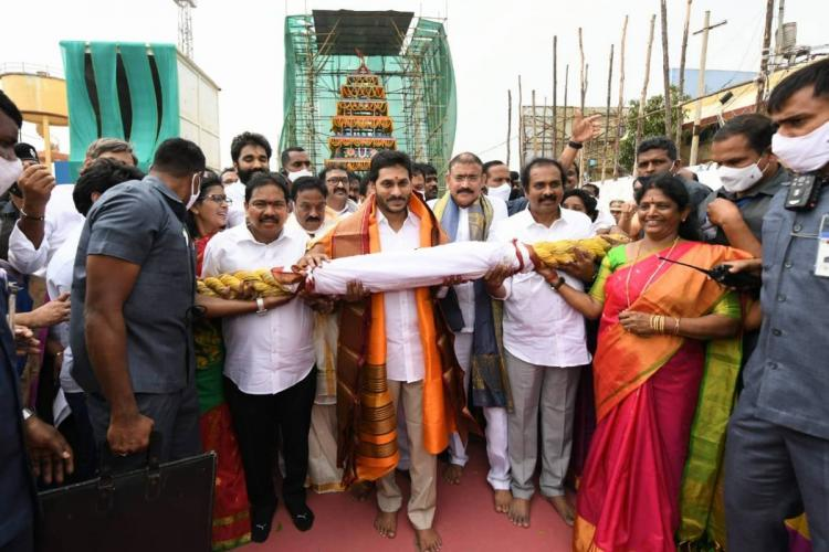 Andhra Pradesh Chief Minister Jagan inaugurating the Antarvedi temple chariot by formally dragging it along with other party leaders and officials