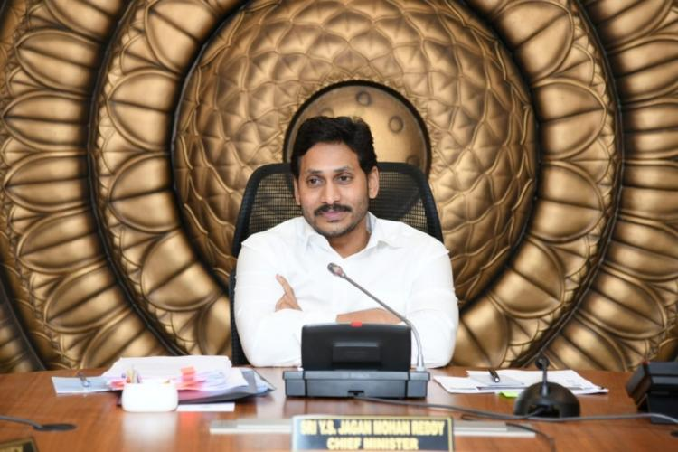 Andhra CM Jagan Mohan Reddy sits behind his desk at a cabinet meeting