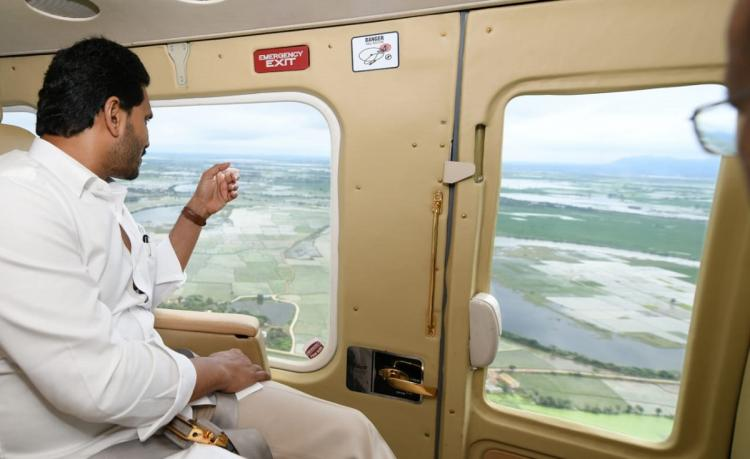Andhra Pradesh Chief Minister YS Jagan Mohan Reddy seen looking out of an aircraft while doing an aerial survey of cyclone affected areas