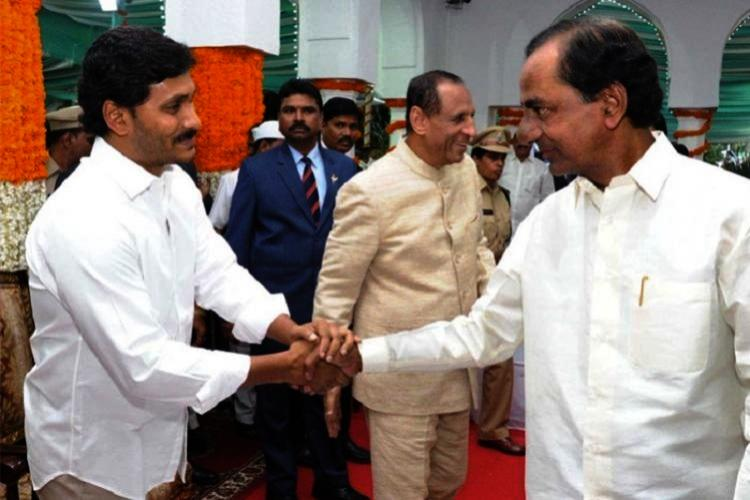 Andhra CM YS Jagan and Telangana CM KCR sharing a moment together in an official programme held by Governor Offfice