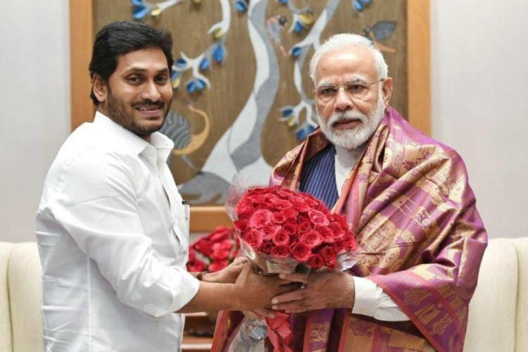 File photo of Jagan honouring Narendra Modi with a shawl and a bouquet