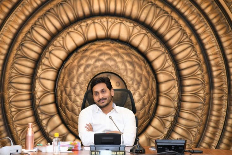 Andhra Pradesh CM Jagan Mohan Reddy sitting in his office and smiling
