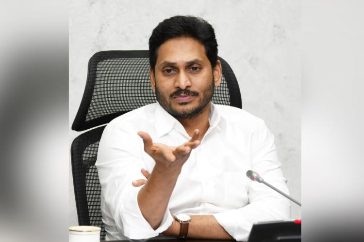 Jagan Mohan Reddy with his hand outstretched