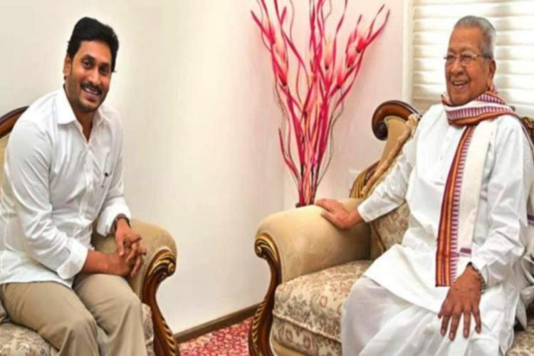 Chief Minister Y S Jagan and Governor Biswabhusan Harichandan seated across each other on sofas and smiling at the camera both are in white clothes
