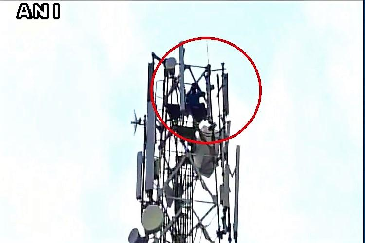 Telangana mans dramatic divorce demand Climbs tower and threatens suicide