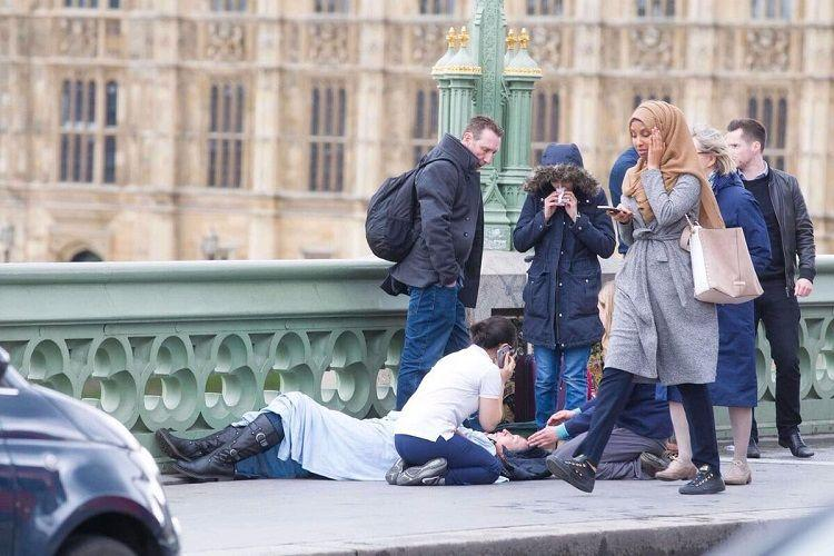 Photographer who captured woman in hijab walking past at the London attack site defends her
