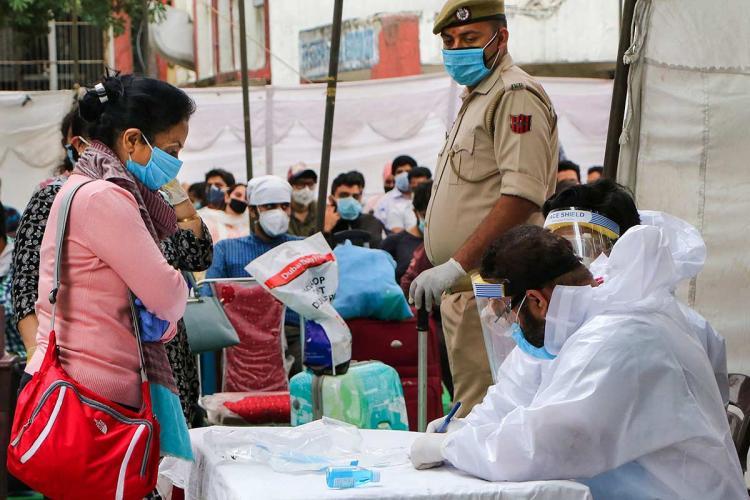 Karnataka reports 84 new COVID-19 cases many have travel history to Maharashtra