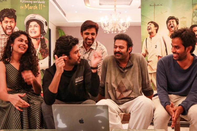 Actors Faria Abdullah, Naveen Polishetty, Priyadarshi and director Anudeep KV with Prabhas at the trailer launch of Jathi Ratnalu
