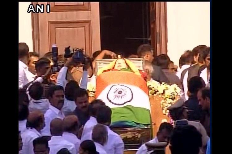 Jayalalithaas funeral at 430 pm today at Marina body kept at Rajaji Hall in Chennai