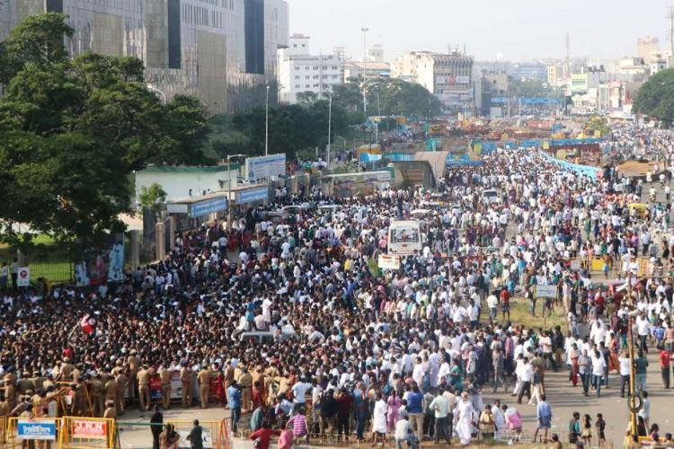 In images Thousands turn up to pay respect to Jayalalithaa at Rajaji Hall in Chennai
