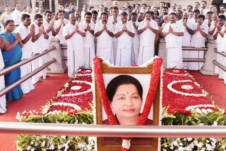 Tamil Nadu ministers paying obeisance to former Chief Minister J Jayalalithaa at her memorial at the Marina beach in Chennai Those paying respects include Edappadi K Palaniswami O Panneerselvam Sellur K Raju and D Jayakumar