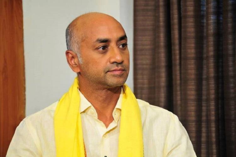 Telugu Desam Party MP Jayadev Galla wearing a yellow party scarf