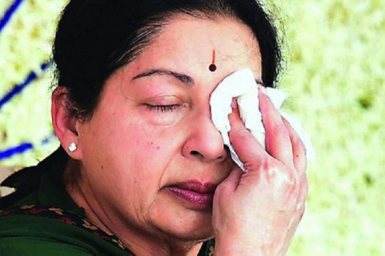 Former chief minister J Jayalalithaa wiping her face with a cloth