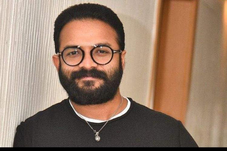 Jayasurya with beard glasses and a black T shirt